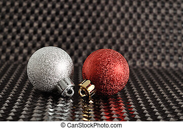 Red and silver Christmas tree baubles isolated on a black background