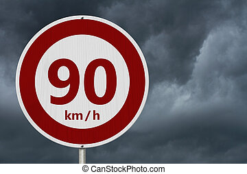 Red and white 90 km speed limit sign