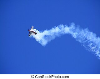 Red and white airplane in the sky - Su-26 airplane flying in...