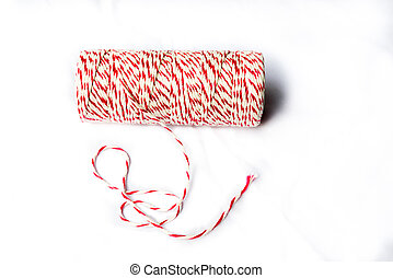 Red and white baker's twine spool on isolated background