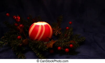 red and white ball candle glowing