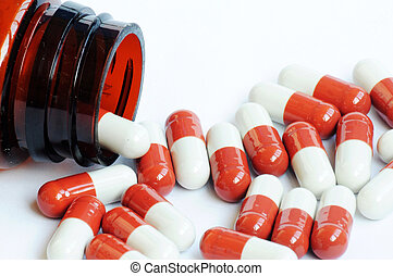 Red-and-white capsules - Red-and-white medicine capsules...