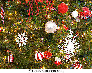 Red and White Christmas Ornaments on a Green Tree with White Lights
