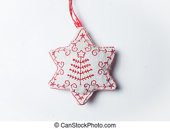 red and white christmas star toy isolated on white