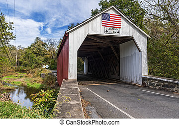 Red and White Covered Bridge
