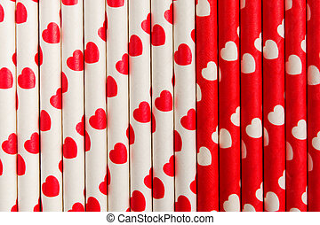 Red and white ecological plastic free paper straw with hearts