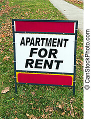 Red and White For Rent Sign on Lawn