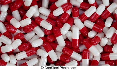 Red And White Health Capsules Rotating Closeup