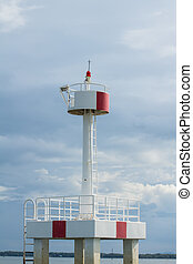 red and white lighthouse in ocean