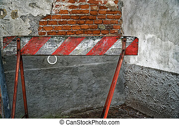 Red and White Lines of wooden barrier . At subway station of airport background Red White warning fencing is protects for No entry