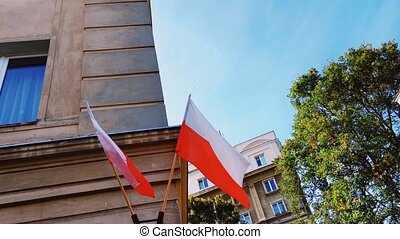 Red and white polish flag on a building in Warsaw, Poland, ...
