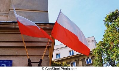 Red and white polish flag on a building in Warsaw, Poland, national independence day. High quality 4k footage