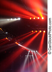 Red and white spot lights in a music concert
