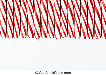 Red and White Striped Peppermint Candies - Close up of...