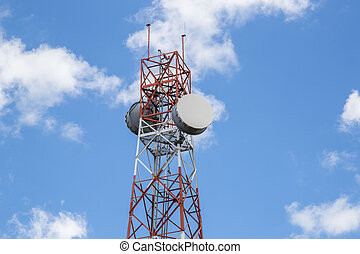 Red and white tower of communications with a lot
