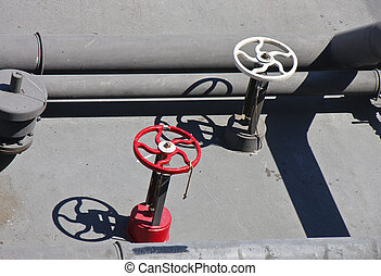 Red and White Valves on Black Industrial Machinery - Control...