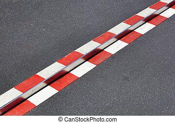 Red and white warning on asphalt
