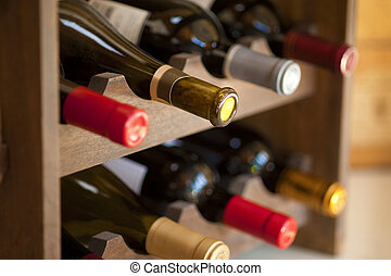 Red and white wine bottles stacked