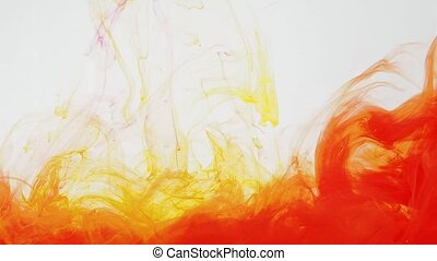 Red and yellow acrylic paint moving in water on white background. Ink swirling in water creating abstract clouds. Traces of colourful ink dissolving in water, ever changing shape. 60fps, HD format.