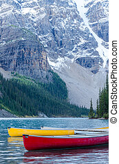Red and yellow canoes on Moraine Lake