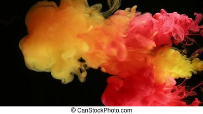 Red And Yellow Ink Paints Colors in Water Creating Shapes -...