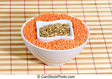 Red and yellow lentils in a white bowl