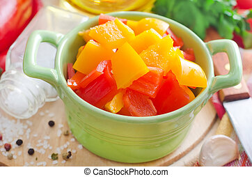 red and yellow peppers on wooden background