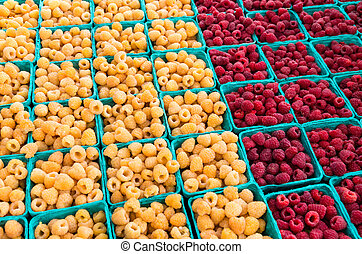 red and yellow raspberries in boxes