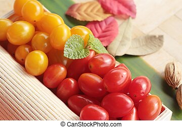Red and yellow tomatoes organic on wood background