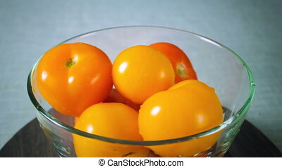 Red and yellow tomatoes spinning plate