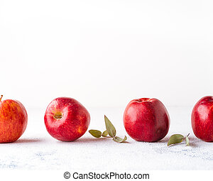 Red appes on white background with copy space