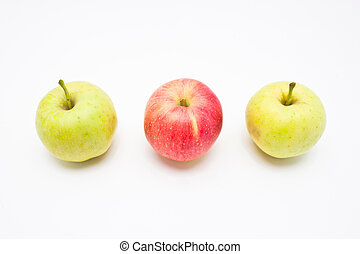Red apple among green apples isolated on white background.