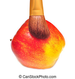 red apple and brush