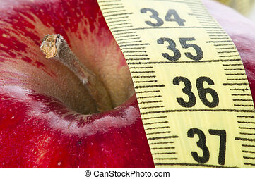 Red apple and centimeter