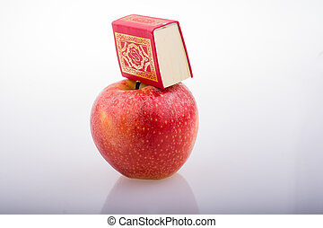 Red apple and  Islamic Holy Book Quran