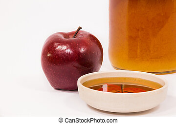 Red apple and jar of honey bowl of honey isolated on a white...