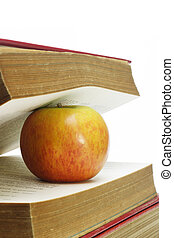 Red apple and old books