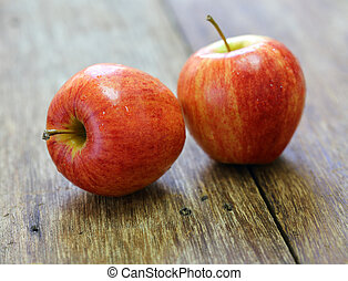 red apple fruit on wood background