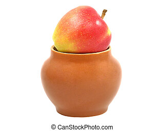 Red apple in a clay pot isolated on white background.
