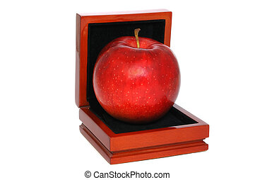 Red apple in jewelry box