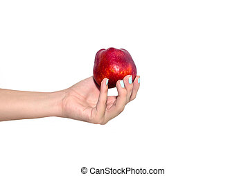 Red apple in woman hand
