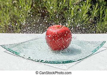 Red apple is the water stream