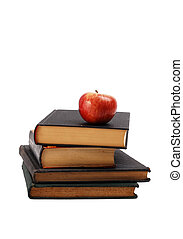 Red apple on a book pile isolated on white