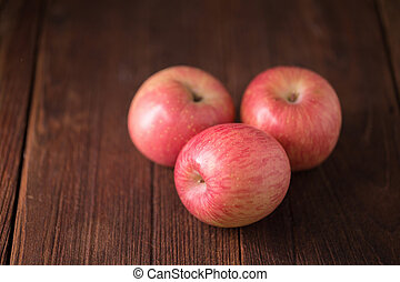 red apple on a wooden background.