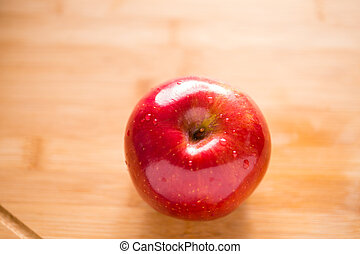Red apple on cutting board
