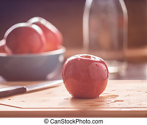 Red apple on cutting board