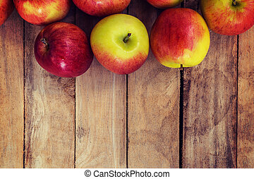 red apple on wood background texture with space for text