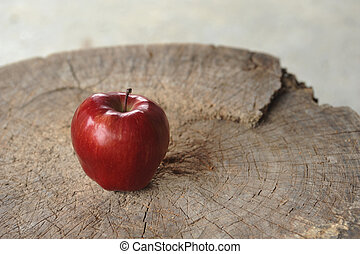 red apple on wood