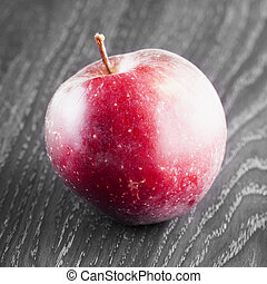 Red apple over black and white background