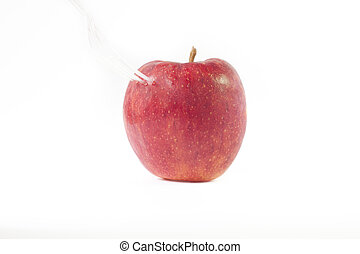 Red apple spoon on white background